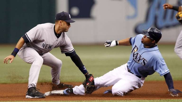 Carl Crawford looks to sign under a tag