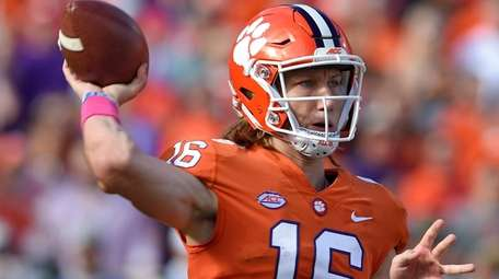 Clemson quarterback Trevor Lawrence throws during the first