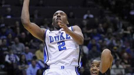 Duke's Nolan Smith, left, puts up a shot