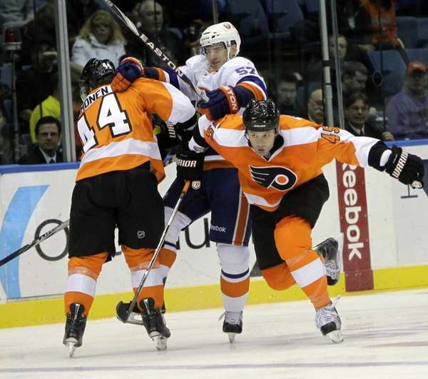 Philadelphia Flyers' Kimmo Timonen, left, blocks New York