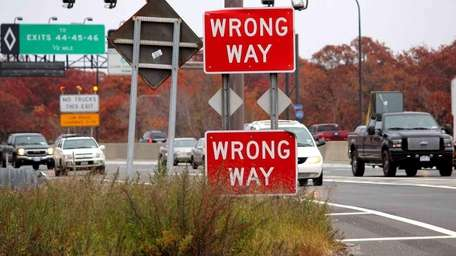 Two 'Wrong Way' signs warn motorists on the
