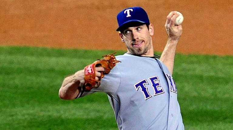 Texas Rangers pitcher Cliff Lee delivers a pitch