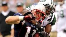 Antonio Cromartie of the Jets tackles Patriots' Julian