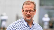 New York Jets general manager Mike Maccagnan walks