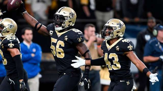 Saints outside linebacker Demario Davis celebrates after recovering