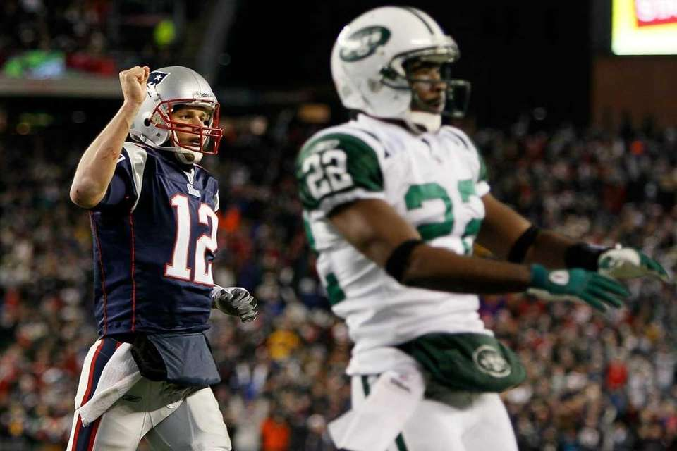 The Patriots' Tom Brady reacts after as Jets