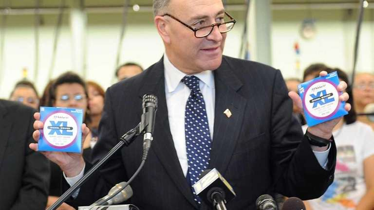 U.S. Sen. Charles Schumer holds authentic D'Addario guitar