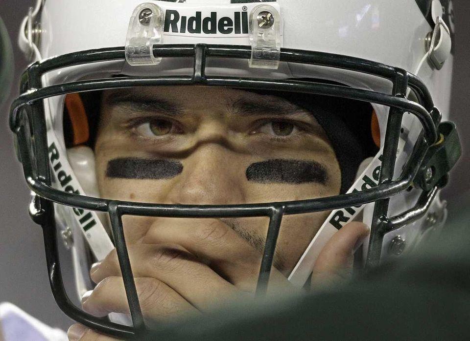 New York Jets quarterback Mark Sanchez (6) listens