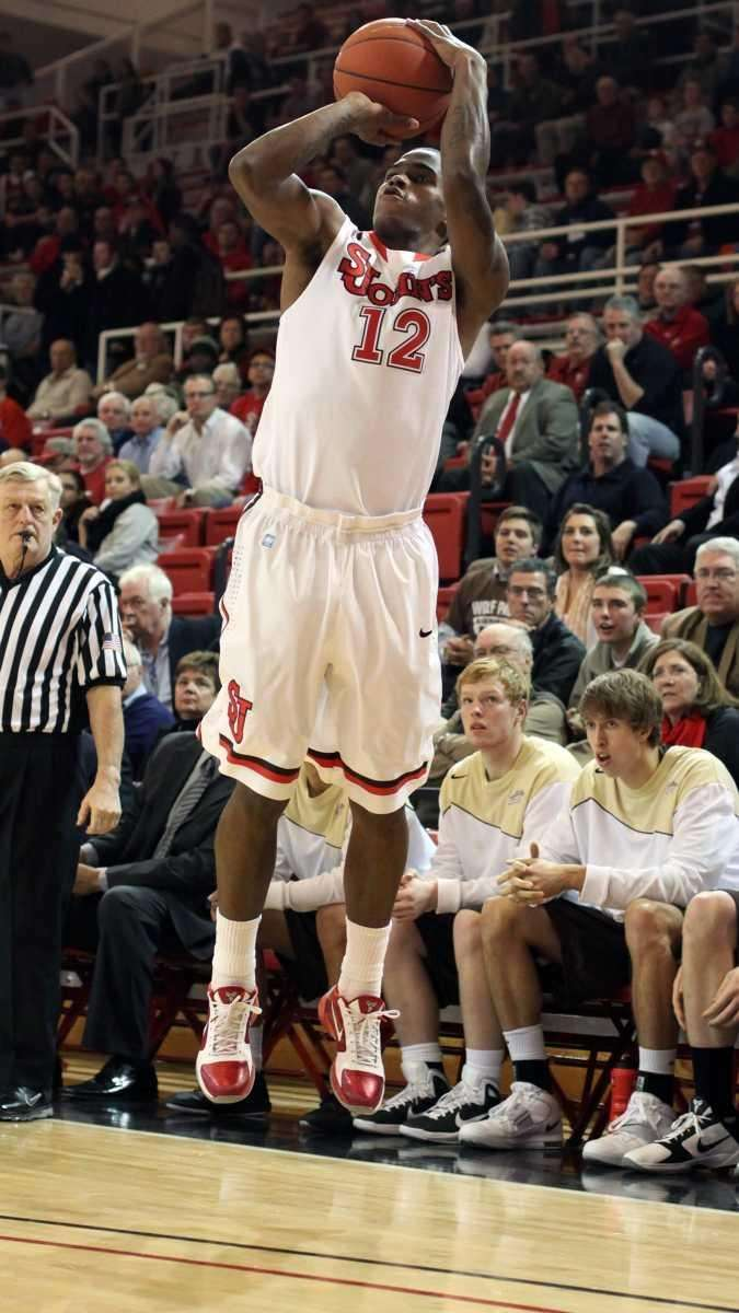 St. John's University's Dwight Hardy attempts a three-pointer.