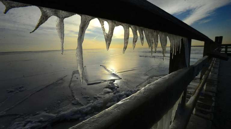 The frozen Great South Bay is viewed through