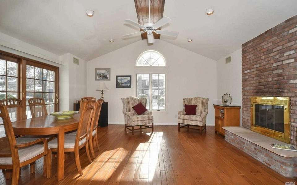 The family room, open to the remodeled kitchen,