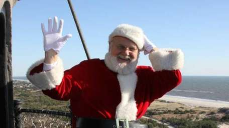 After the plane disappears from sight, Santa appears