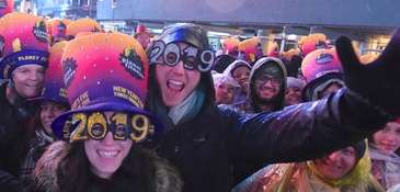The rain didn't dampen spirits as revelers gathered