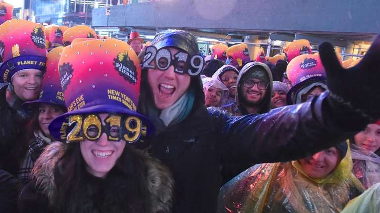 The rain didn't dampen spirits as revelers gathered