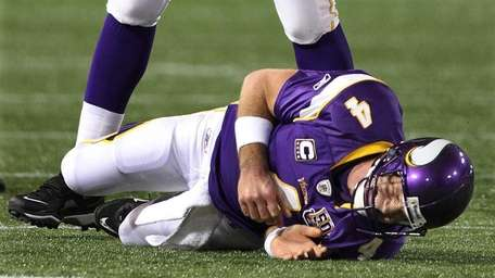 Minnesota Vikings quarterback Brett Favre (4) reacts after