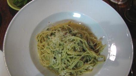 Spaghetti carbonara in a simple white bowl is