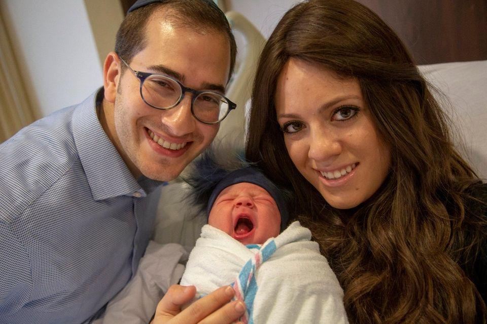 Eli Derdik and his wife, Adina, with their