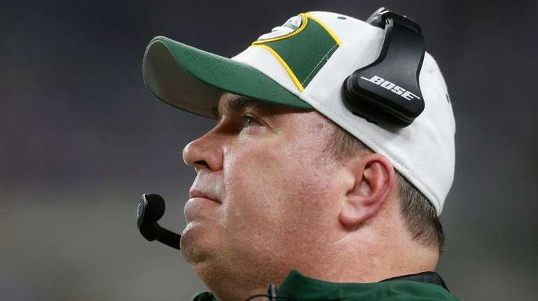 Then-Packers head coach Mike McCarthy watches from the