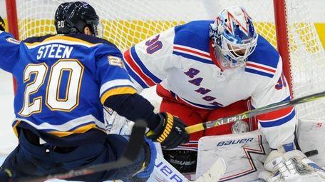 Rangers goalie Henrik Lundqvist blocks a shot by