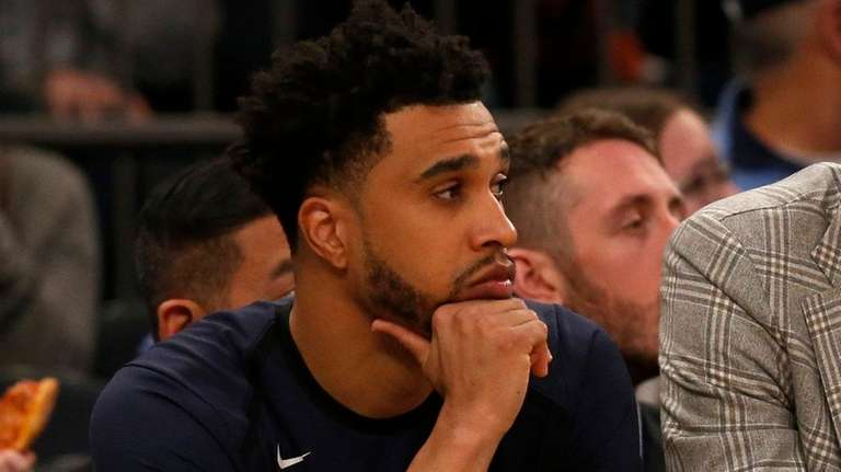 The Knicks' Courtney Lee looks on from the