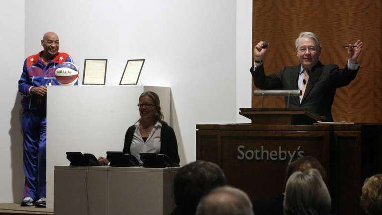 Auctioneer David Redden gavels closed the bidding for