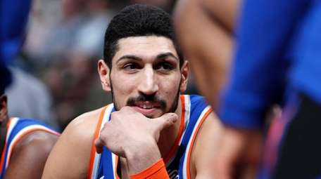 Knicks center Enes Kanter jokes with teammates during
