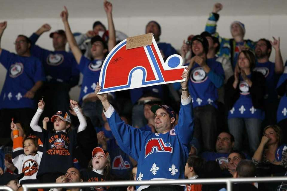 Members of 'Nordiques Nation' cheer during the NHL