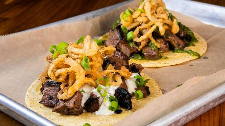 The Steakhouse taco (front) and chimichurri taco both
