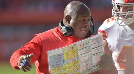 Kansas City Chiefs offensive coordinator Eric Bieniemy walks