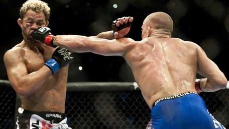 Georges St-Pierre, right, punches Josh Koscheck in the