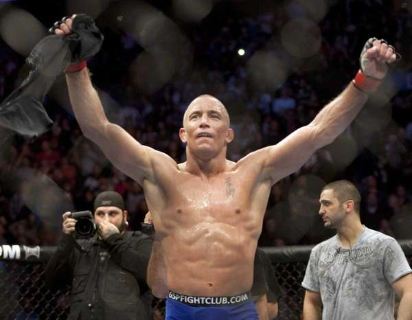 Georges St-Pierre, from Montreal celebrates after defeating Josh