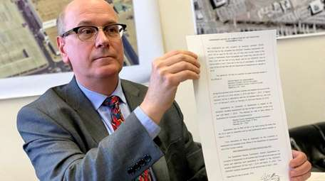 Nassau County Assessor David Moog with the notice