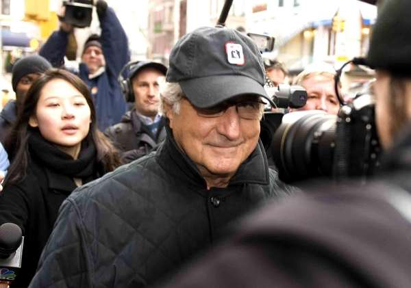 Bernard Madoff walks down Lexington Avenue to his