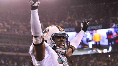 Chris Clemons of the Miami Dolphins celebrates after