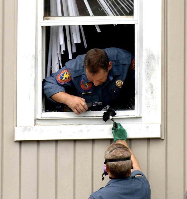 Nassau County Police crime scene investigators collect evidence