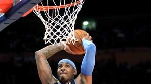 Denver Nuggets' Carmelo Anthony dunks the ball in