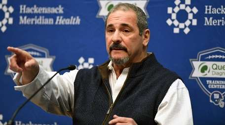 Giants general manager Dave Gettleman answers questions during