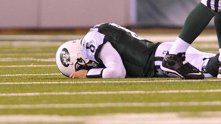 Mark Sanchez lies face down on the turf