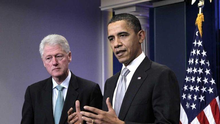 President Barack Obama, accompanied by former President Bill