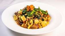 Orecchiette Pugliesi features ear-shaped pasta, sausage and broccoli