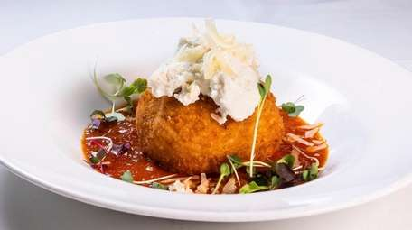 The arancino is a a soft-ball-sized rice ball