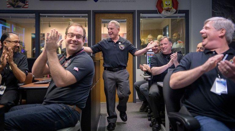 A NASA photo shows principal investigator Alan Stern,