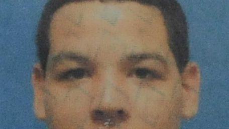 Handout photo of taxi driver, Juan Rosario, 19,