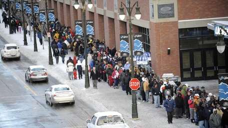 Fans wait in line in the bitter cold