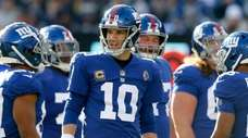 Eli Manning of the Giants looks on in