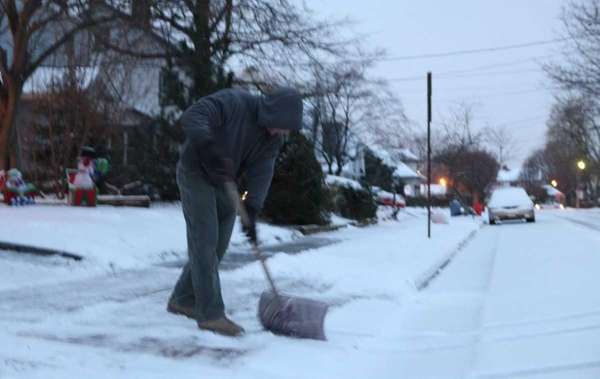 John Fucci clears his snow covered walkway on