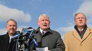 Flanked by Chief of Detectives Dominick Varrone, left,