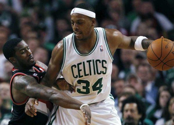 Boston Celtics' Paul Pierce (34) keeps the ball