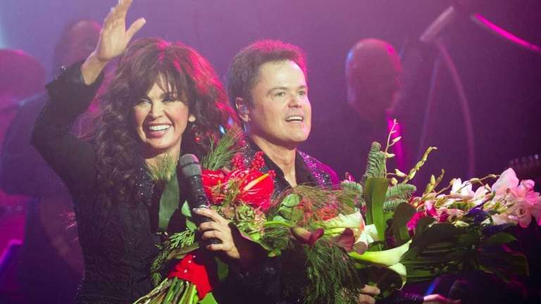 Marie Osmond, left, and Donny Osmond appear at