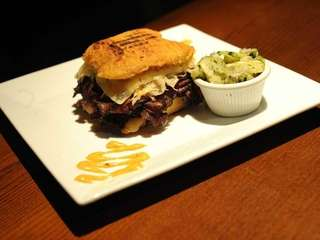 A pastrami knish sandwich is one of the